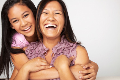 Laughing mom and daughter