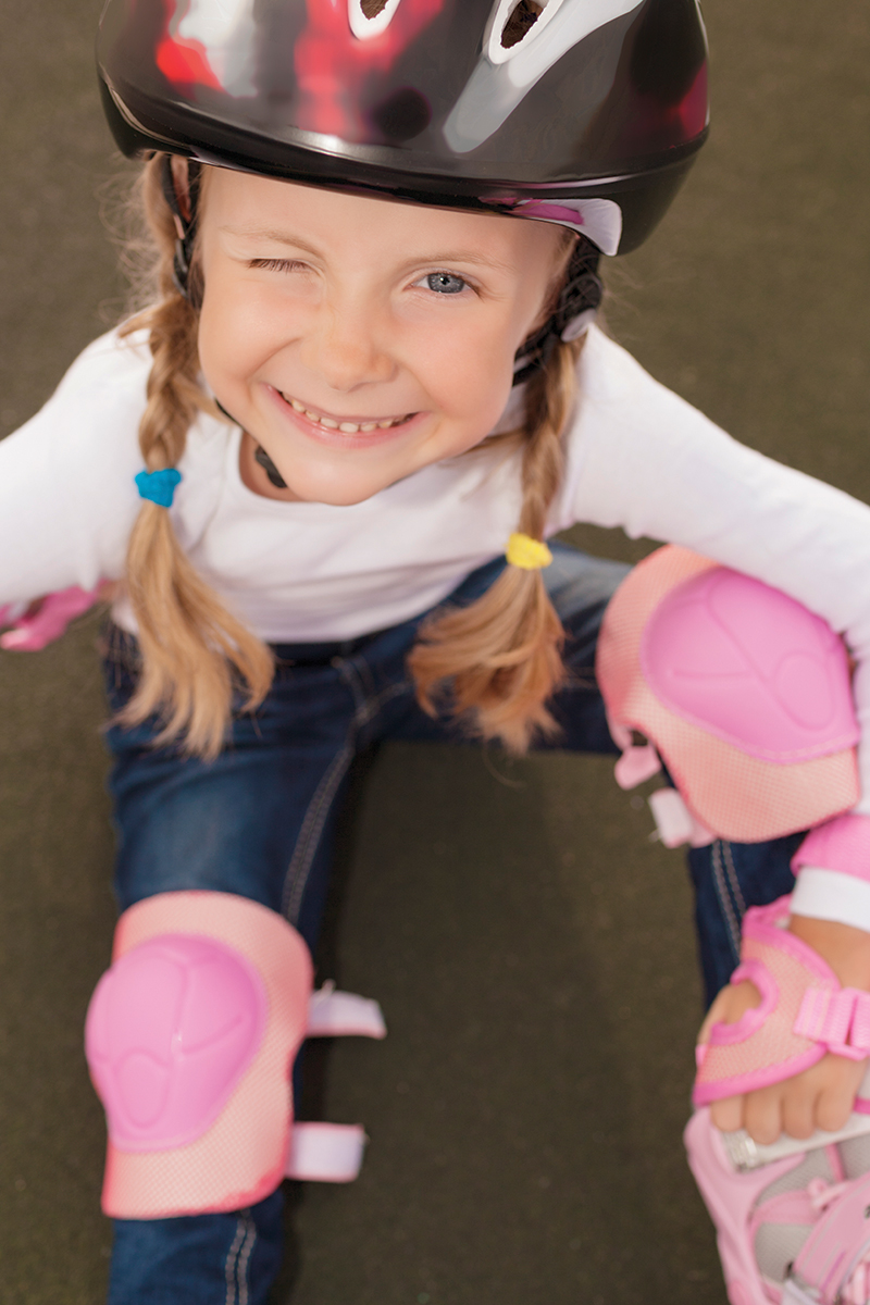 little girl learning to roller skate