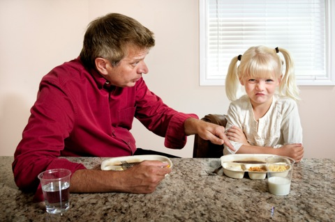 dad with daughter at mealtime