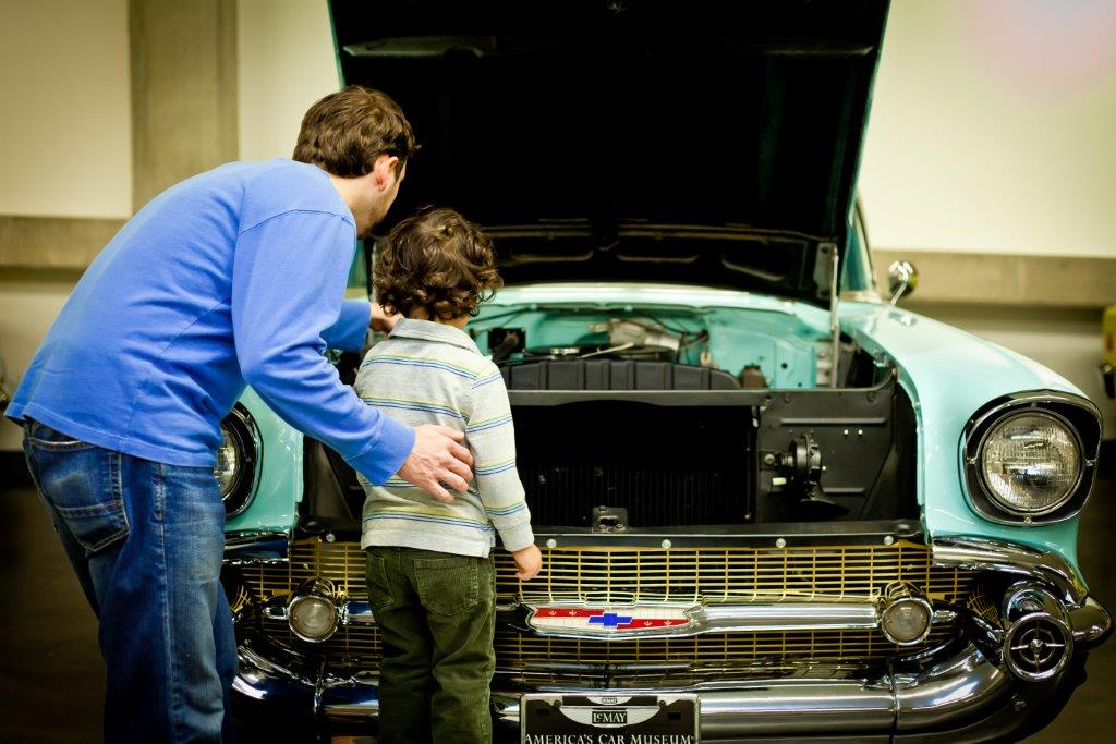 father boy old car museum