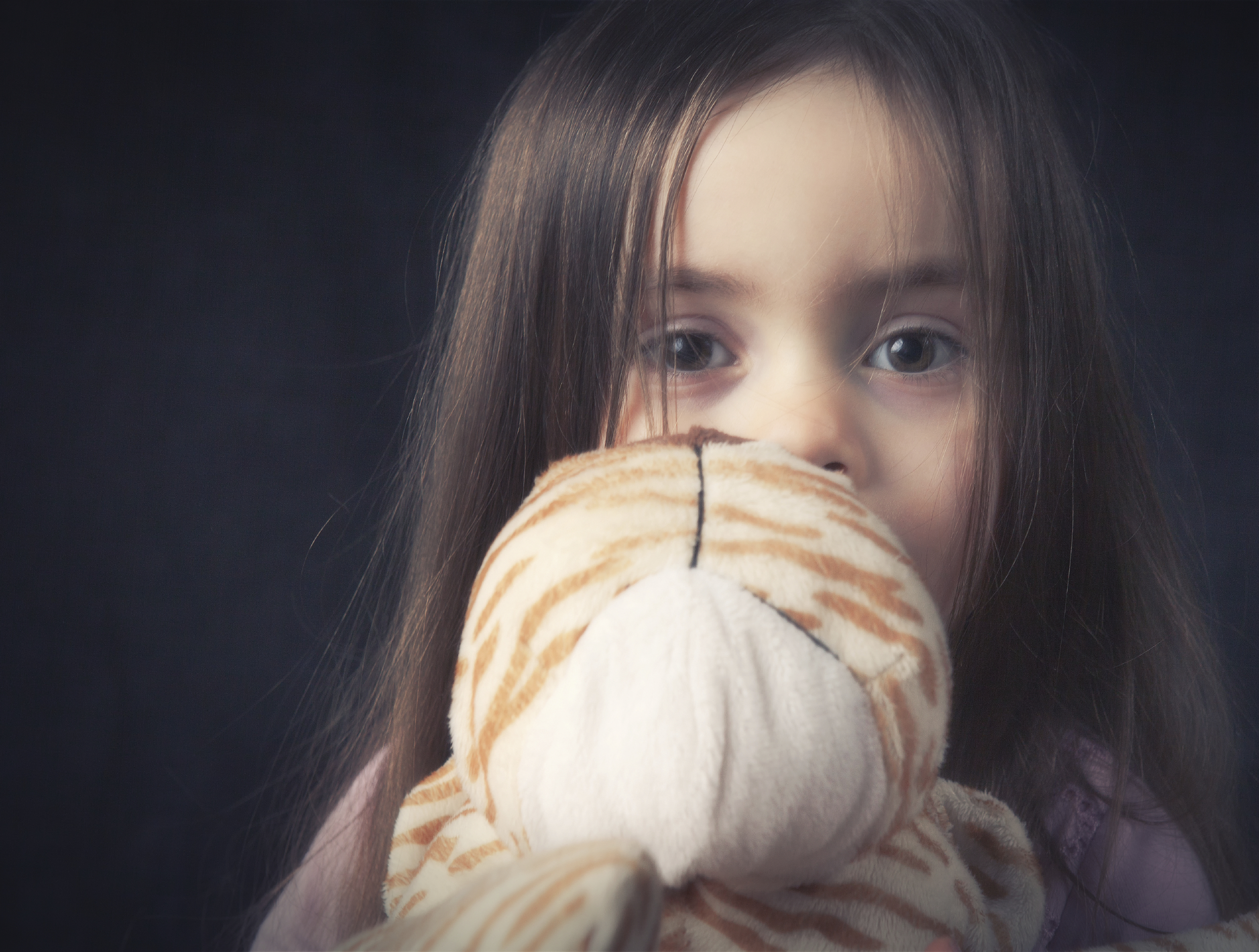 anxious little girl with stuffed animal