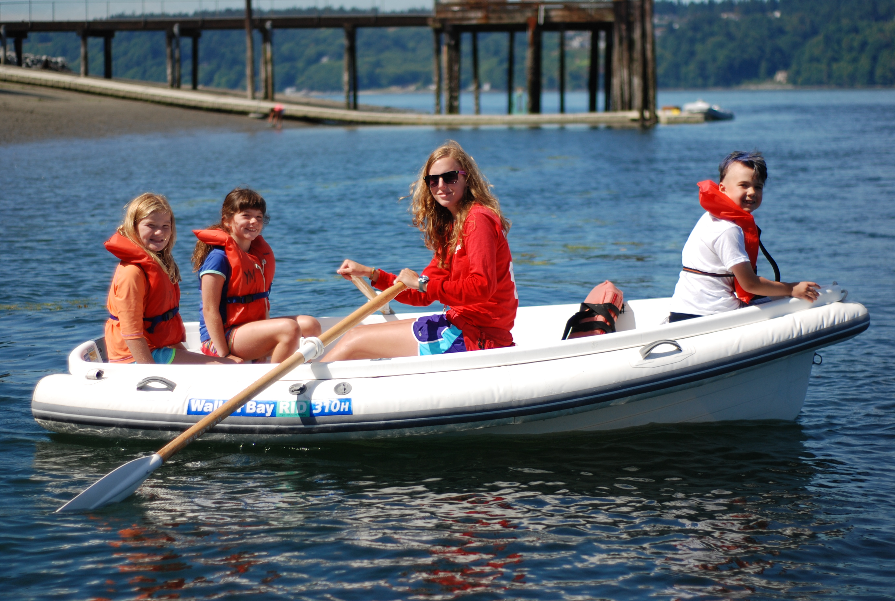 Campers in boat at Camp Sealth