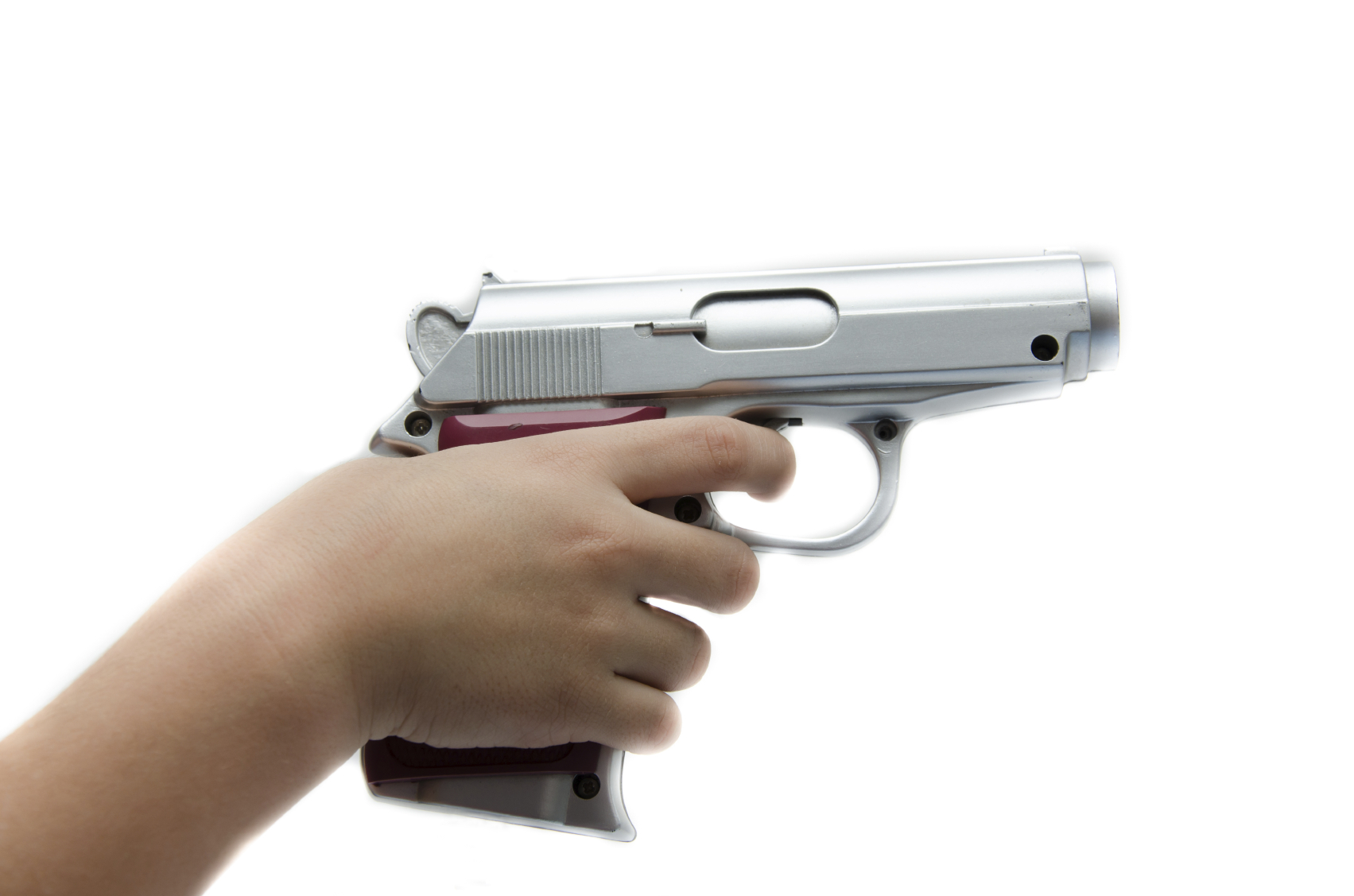 child's hand holding a gun