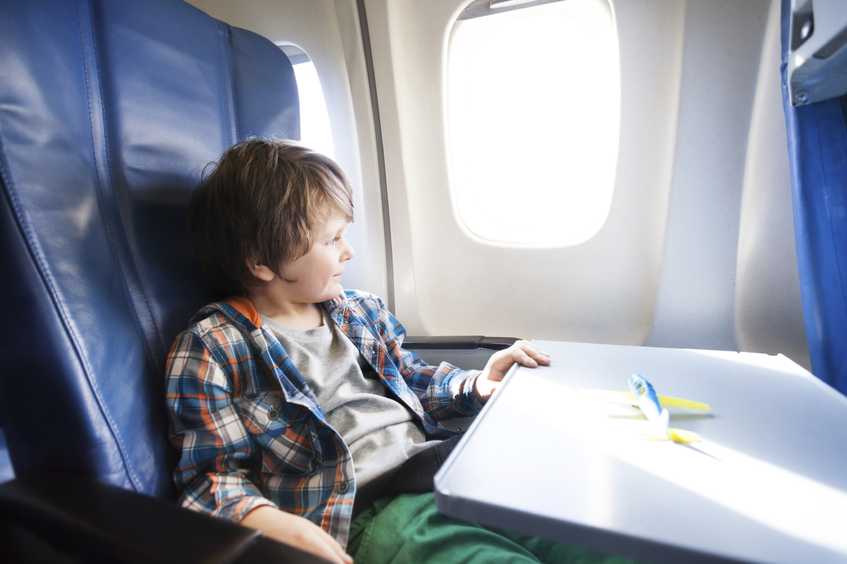 Cute little tired kid boy at the airport, traveling. upset ...  Little Boy Traveling