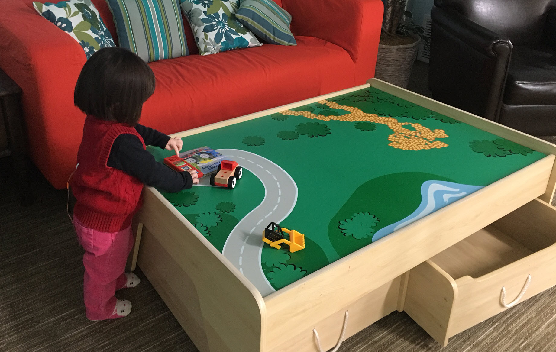 Couches and train table, JuzPlay. Photo credit: April Chan