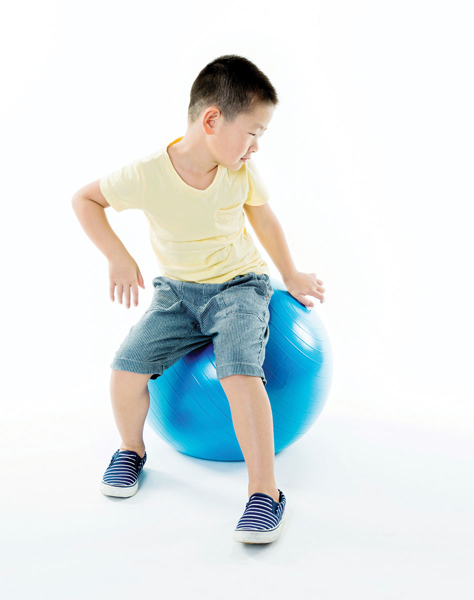 kid on yoga ball