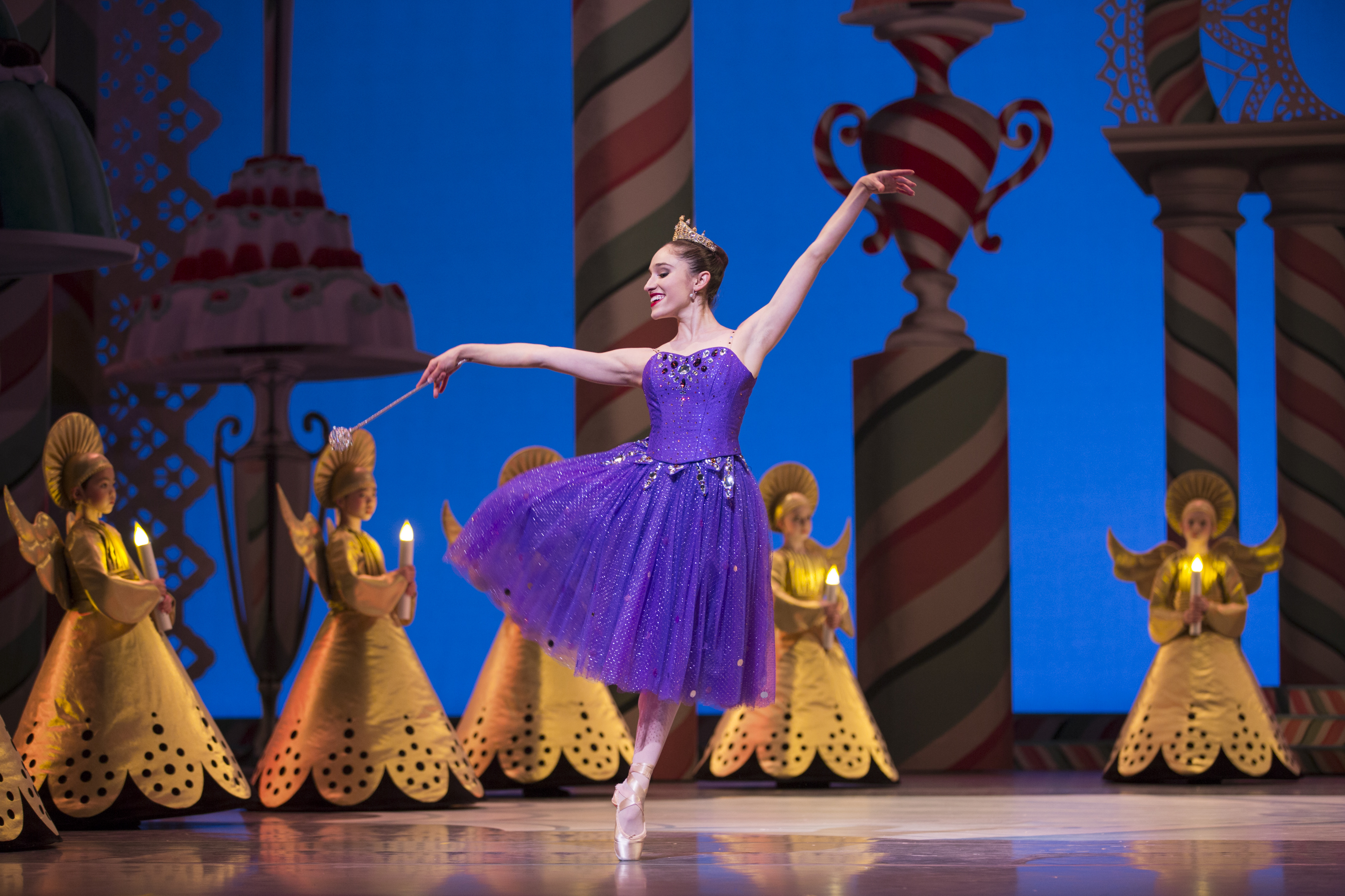 Pacific Northwest Ballet soloist Leta Biasucci as the Sugar Plum Fairy, with PNB School students in George Balanchine's The Nutcracker®, choreographed by George Balanchine © The George Balanchine Trust. PNB's production features sets and costumes designed by children's author and illustrator Ian Falconer (Olivia the Pig) and runs November 25 – December 28, 2016. Photo © Angela Sterling.