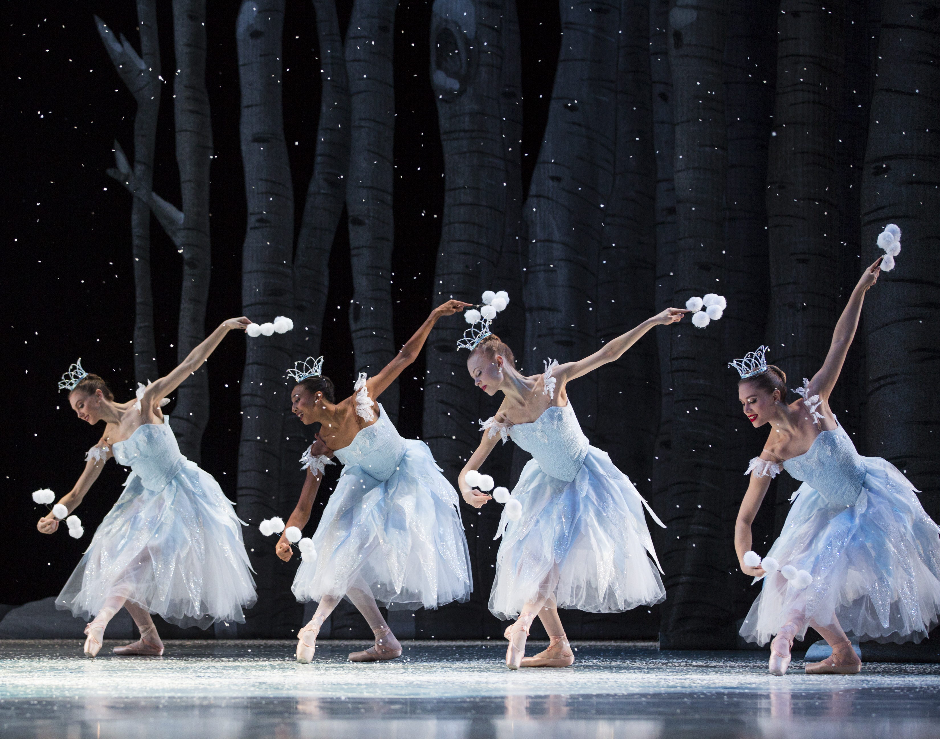 Pacific Northwest Ballet company dancers in the snow scene from George Balanchine's The Nutcracker®, choreographed by George Balanchine © The George Balanchine Trust. PNB's production features sets and costumes designed by children's author and illustrator Ian Falconer (Olivia the Pig) and runs November 25 – December 28, 2016. Photo © Angela Sterling.
