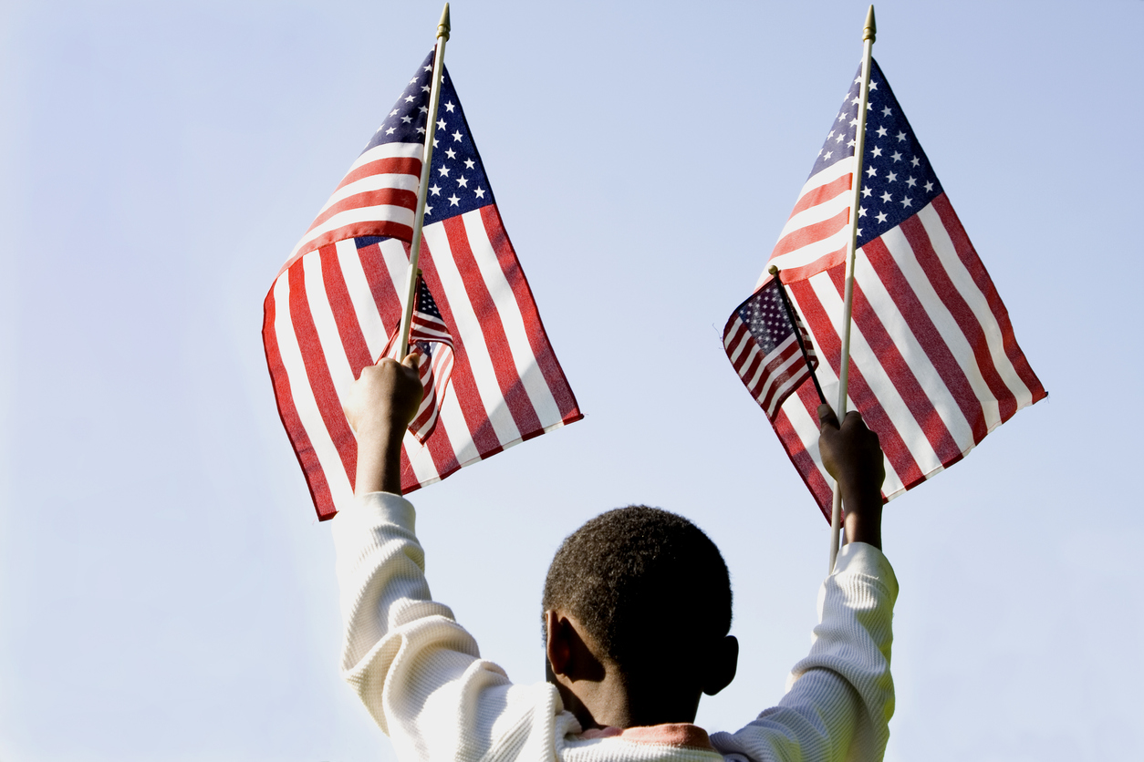 black boy holding american flag