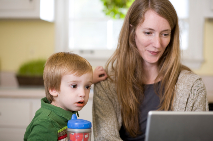 Mom and toddler check out resources online