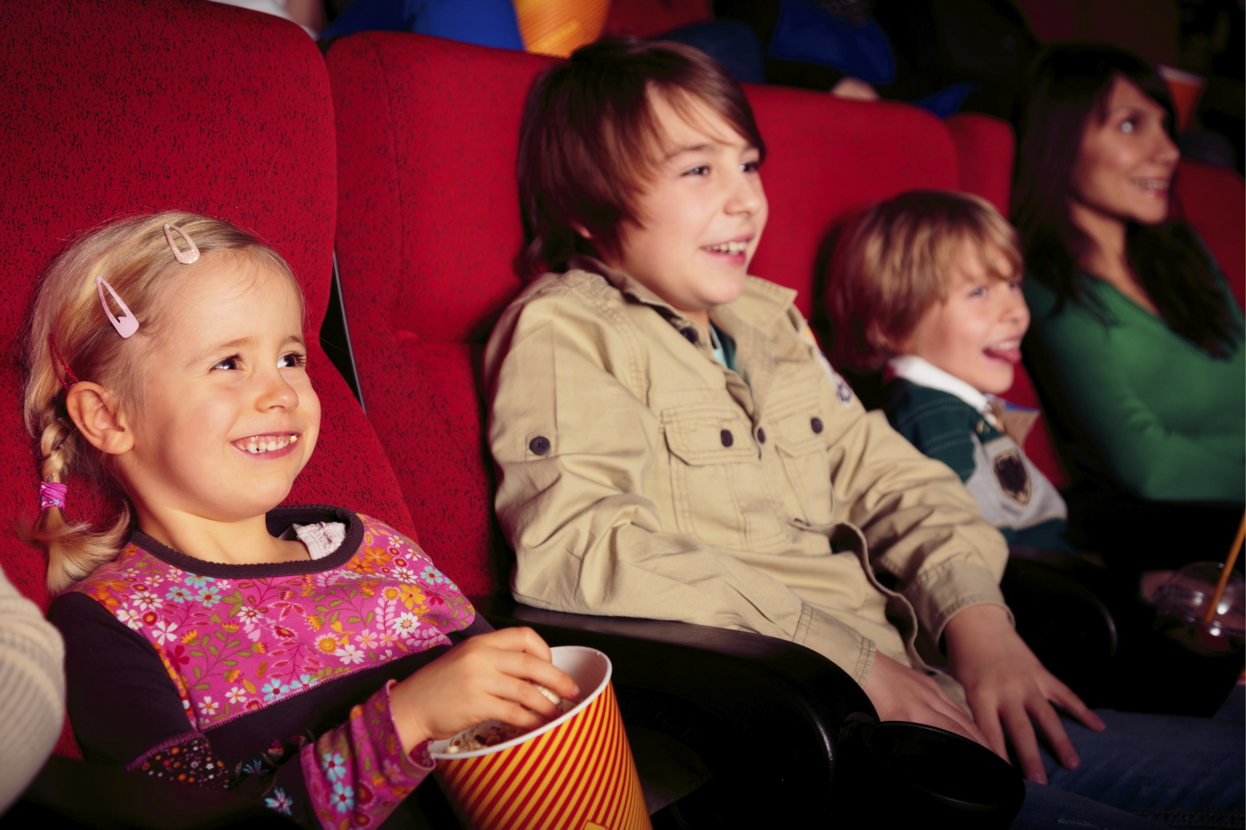 istock kids at movie theater family night out rainy day
