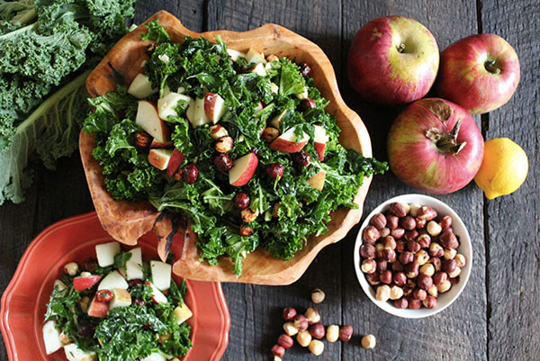 Healthy Thanksgiving side dish: Kale salad with Fuji apples and maple-spiced hazelnuts by Nutrition Stripped