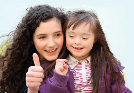 Special Needs Children Beautiful Down Syndrome Girl and Sister