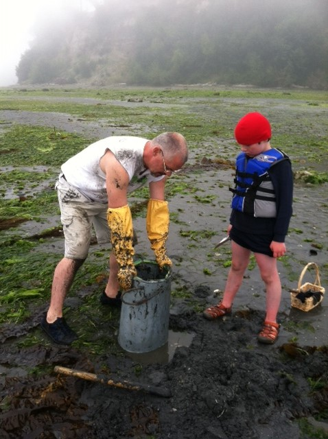 James Mize and son digging geoducks family clamming trips
