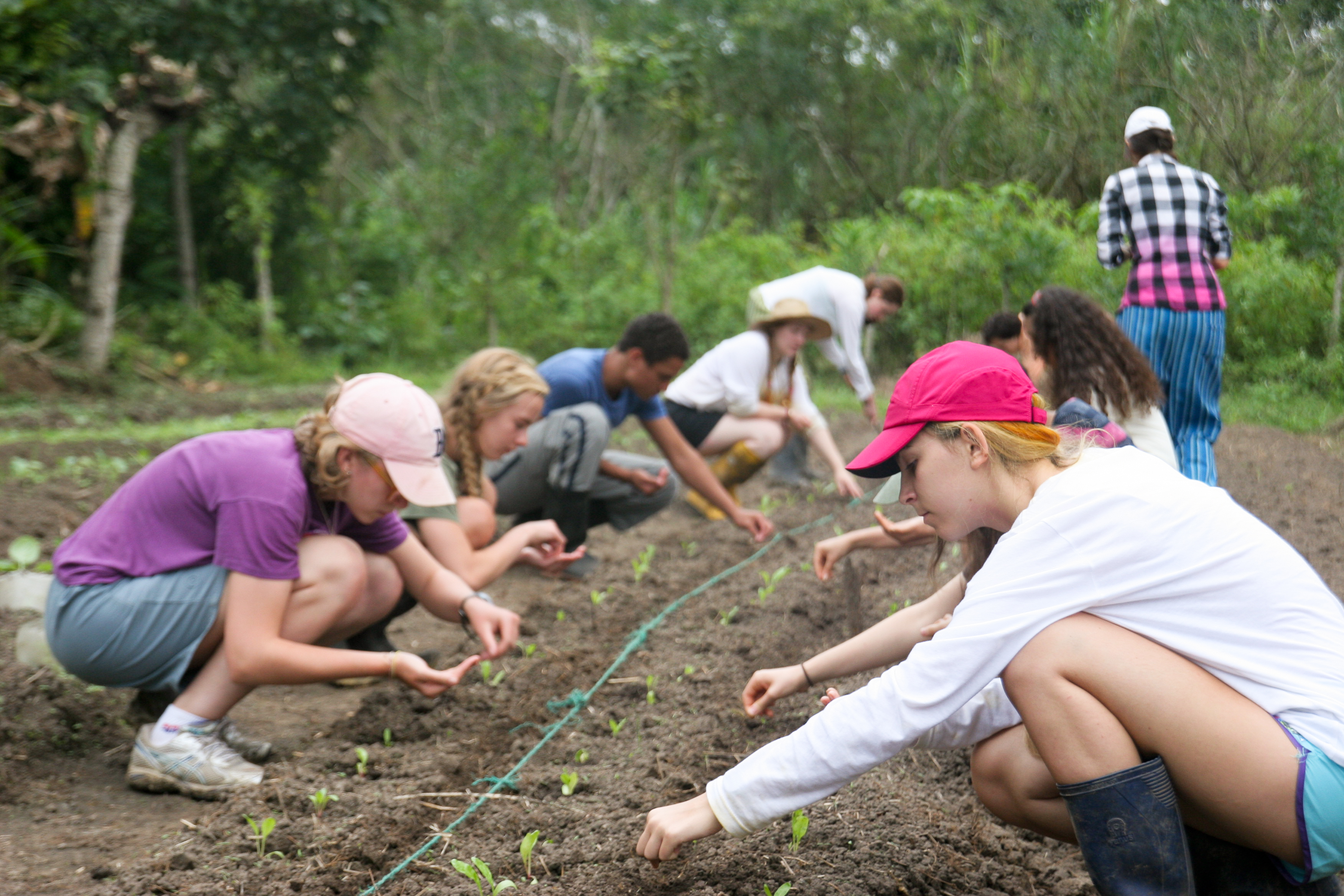 Sustainable Summer Photo of Teens learning organic gardening principles international travel study abroad