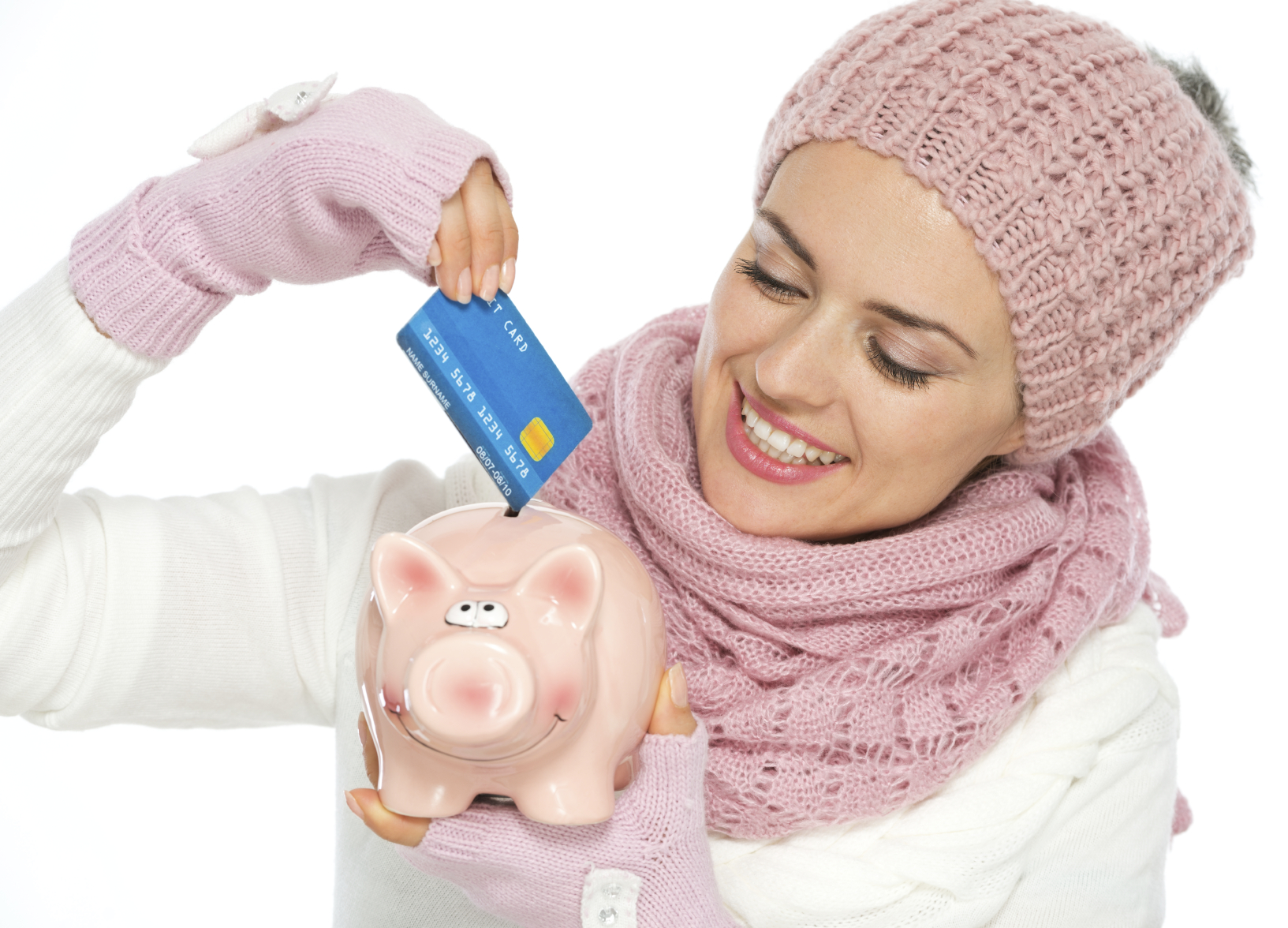 woman mother putting credit card into piggy bank saving points for traveling and airline miles