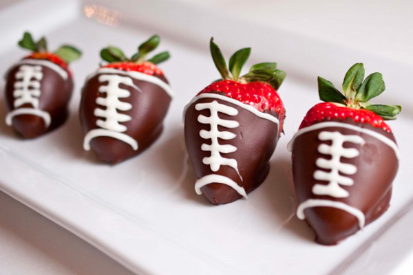 Super Bowl Snack: chocolate-covered football strawberries by Domestic Fits