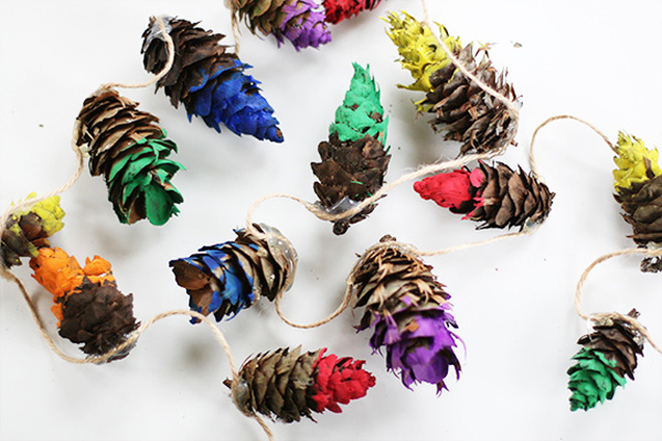 Homemade Christmas rainbow-dipped pinecone garland by Say Yes to Hoboken
