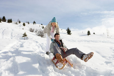 Sledding couple