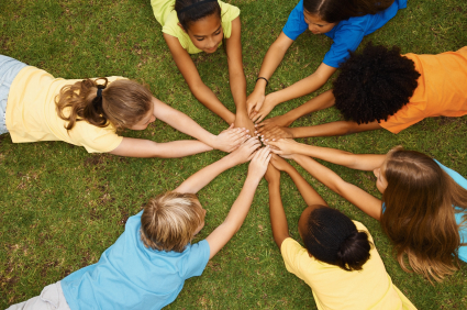 Children in a circle with hands together