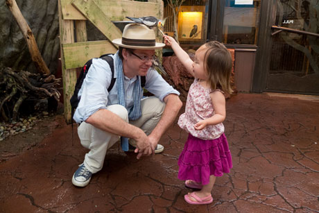Seattle dad Stuart Isett with his daughter at the zoo.