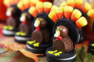 Thanksgiving Oreo turkeys and Cookie pilgrim hats by Our Best Bites