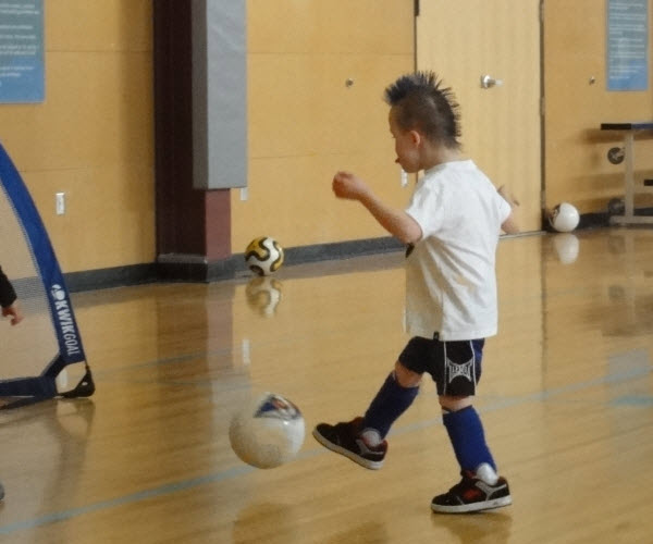 Alexi playing soccer