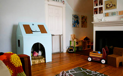 Homemade cardboard playhouse by Make Baby Stuff