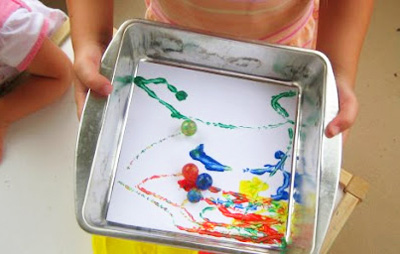 Marble painting with kids by The Mother Huddle