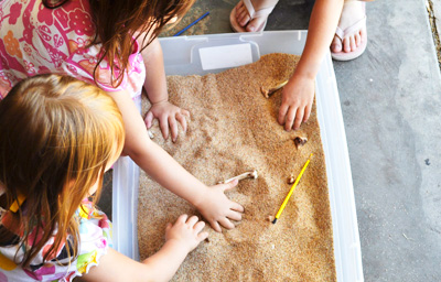Dinosaur sensory tub for kids by Motherhood on a Dime