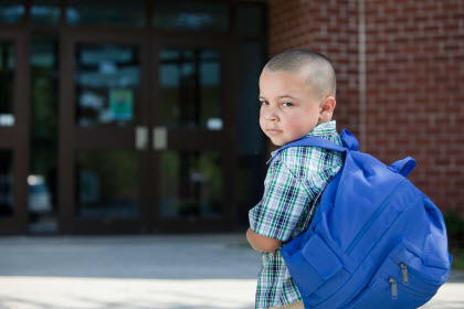 boy looking back as he goes to school