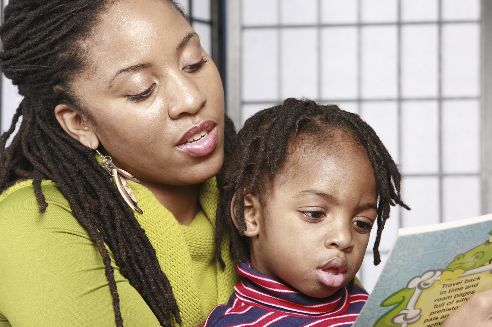 Mom teaching child to read