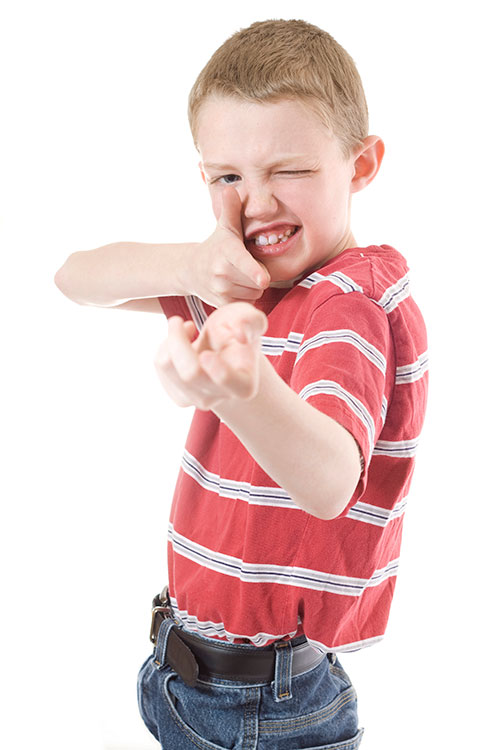Boy holding imaginary playing with toy guns