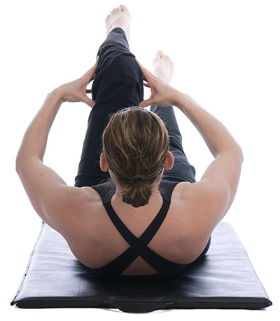 woman doing yoga indoor workouts winter