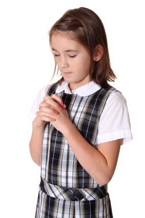 Girl praying in School Uniform