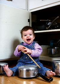 Baby with pots and pans