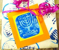 Menorah gift wrap for Hanukkah by Creative Jewish Mom