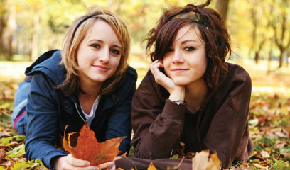 happy teenage girls in the fall outside