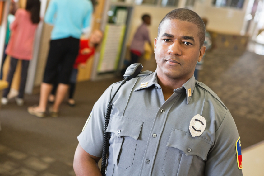 school safety preventing shootings police security officer in hallway class