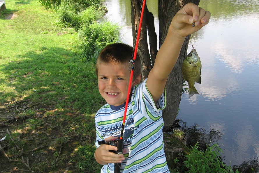 Boy with fishing pole and fish