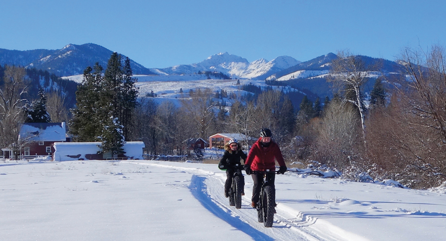 family fat biking in the snow