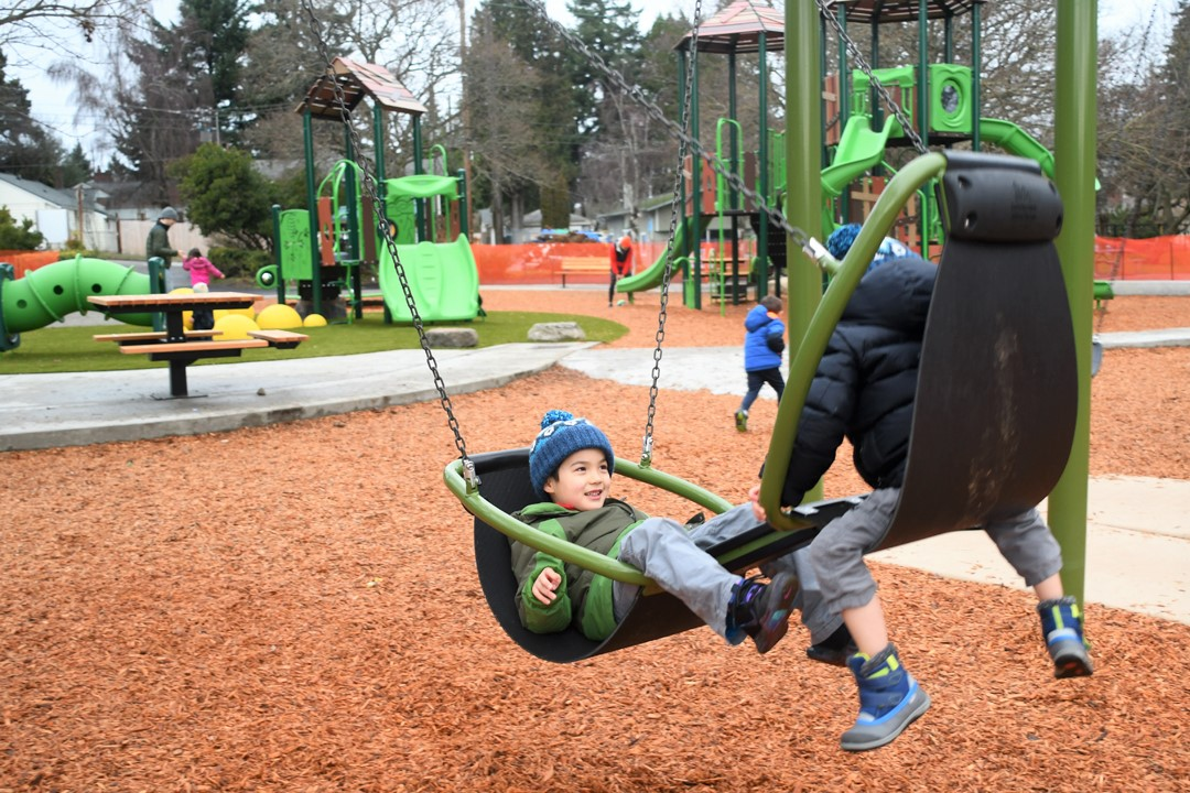 EC-Hughes-double-swing-kids-laughing-new-playground-west-seattle