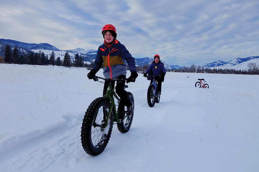 father and son fat biking