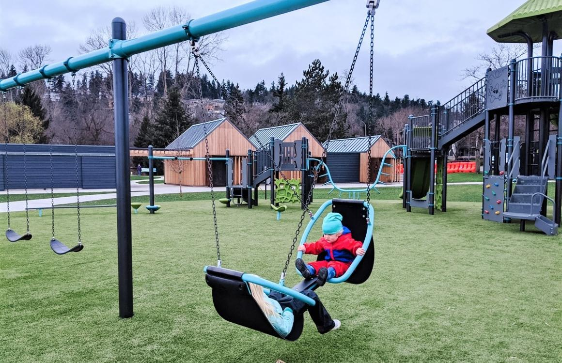 Swings at new all-abilities Juanita Beach Park playground in Kirkland for Seattle and Eastside families