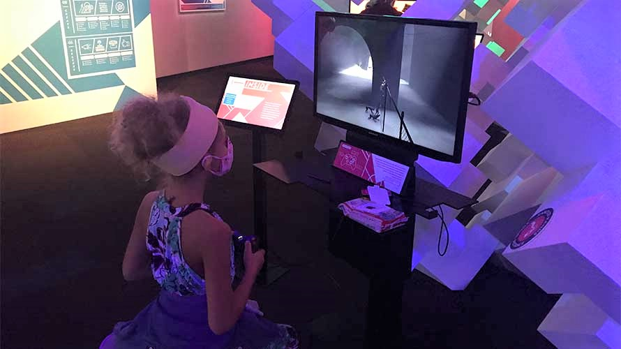 Girl playing at MoPop Indie Game Revolution reopened museum Seattle