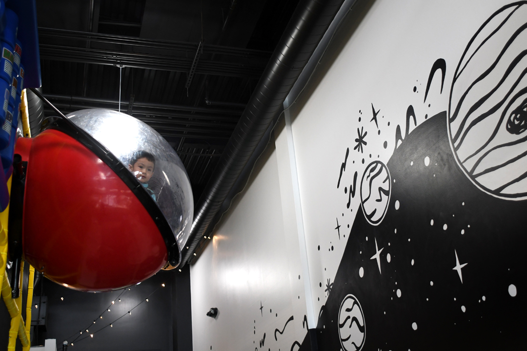 Kid-in-space-capsule-at-outer-space-indoor-play-space-west-seattle