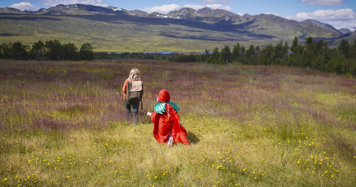 Video still of two girls walking in a meadow from the film Sisters: The Summer We Found Our Superpowers Children's Film Festival Seattle 2021
