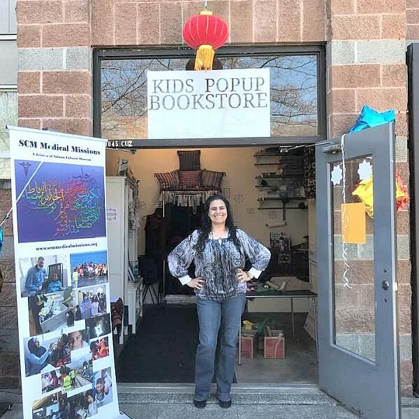 "Koloud ""Kay"" Tarapolsi pictured in front of her pop-up bookstore, Our Little Voices"