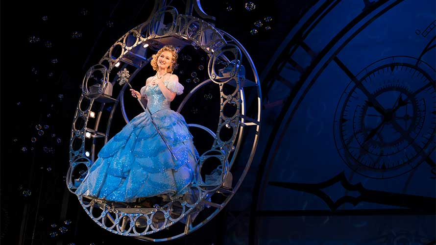 Glinda (Erin Mackey) floating on a bubble wand in Wicked
