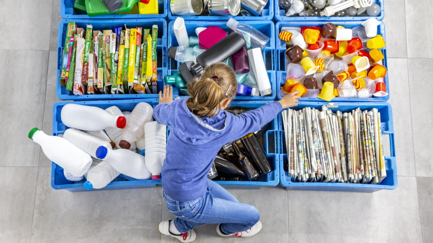 Kid-organizing-recycled-items